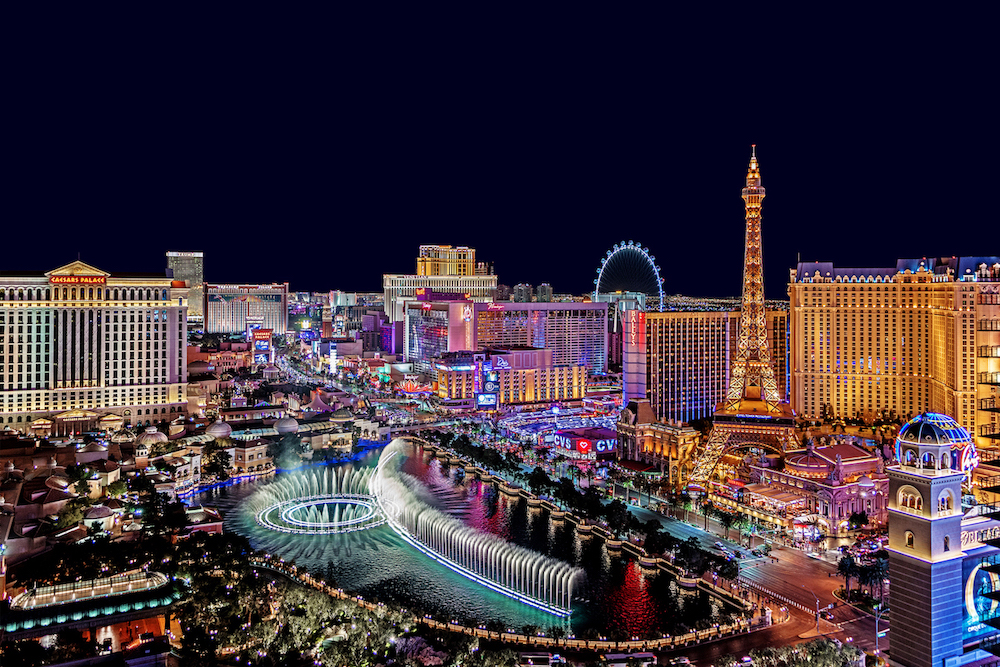 The Famous Las Vegas Strip With The Bellagio Fountain. The Strip Is Home To The Largest Hotels And Casinos In The World.