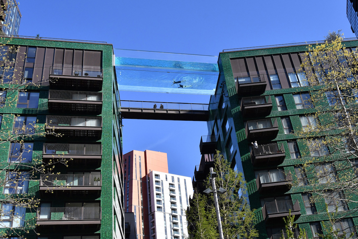 The See Through Pool Is Between Two Buildings